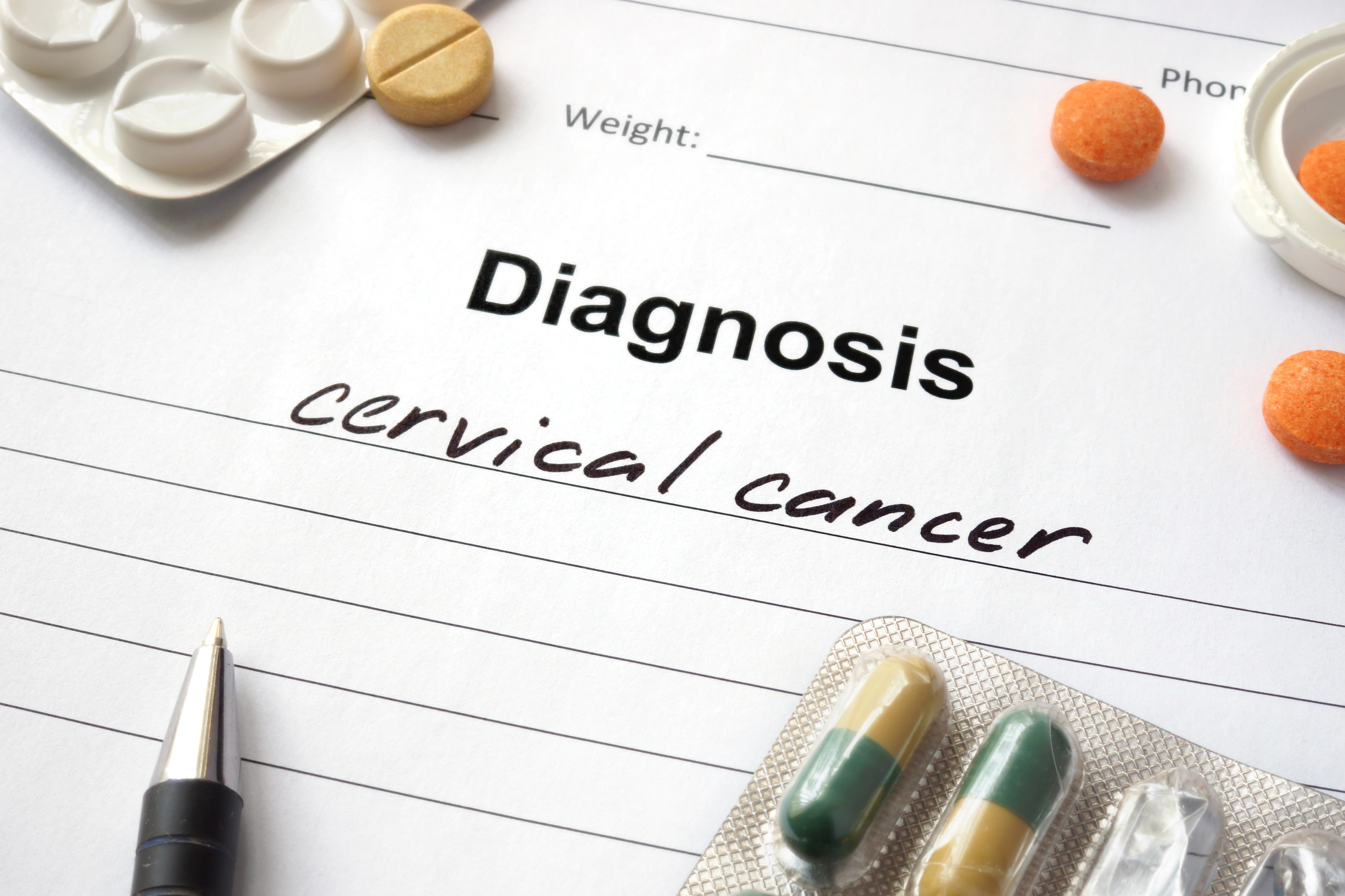 Diagnosis cervical cancer written in the diagnostic form and pills.