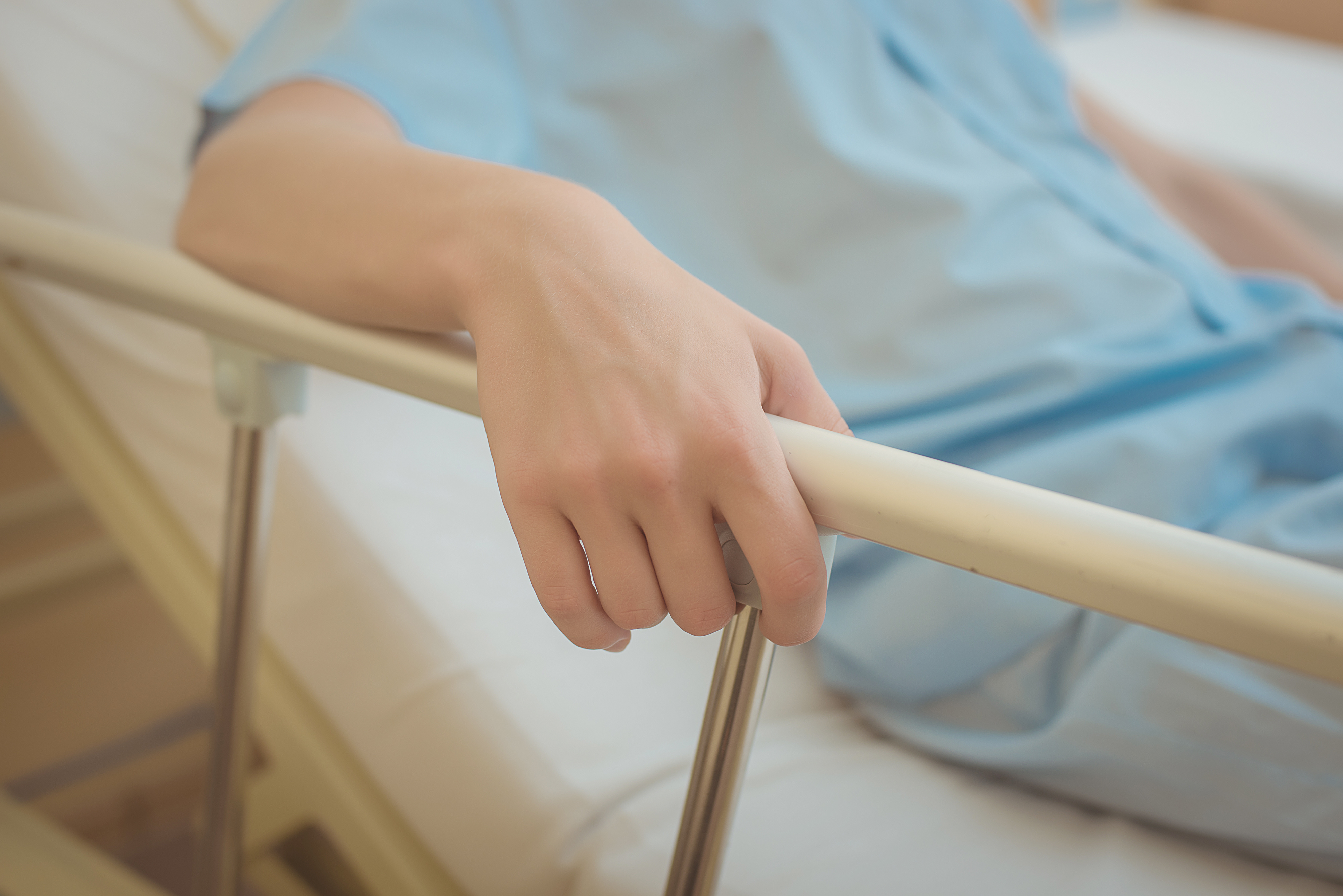 pressure ulcers patient's arm holding on to the bed