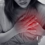 Woman is clutching her chest, acute pain possible heart attack