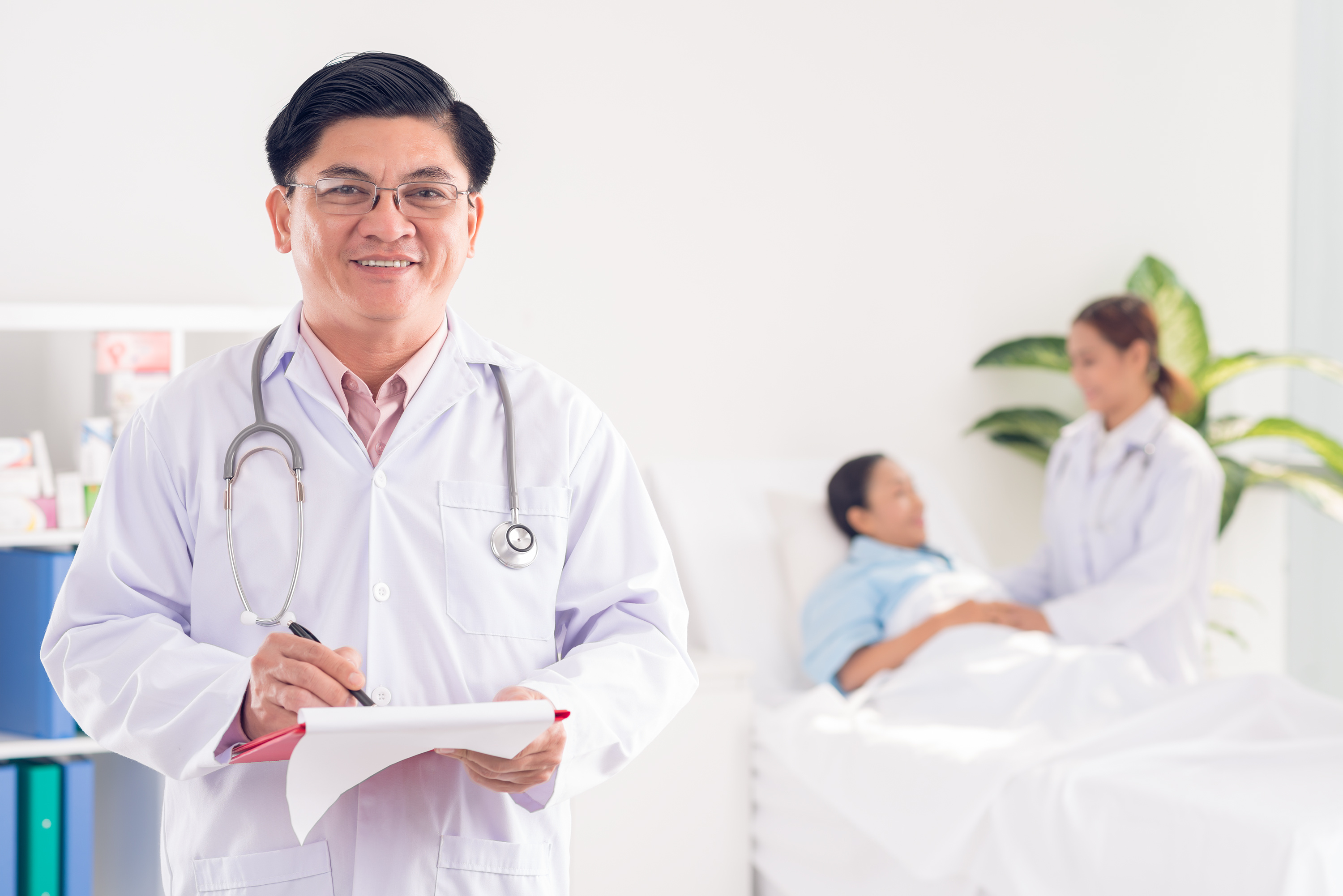 Mature doctor at his patient's ward