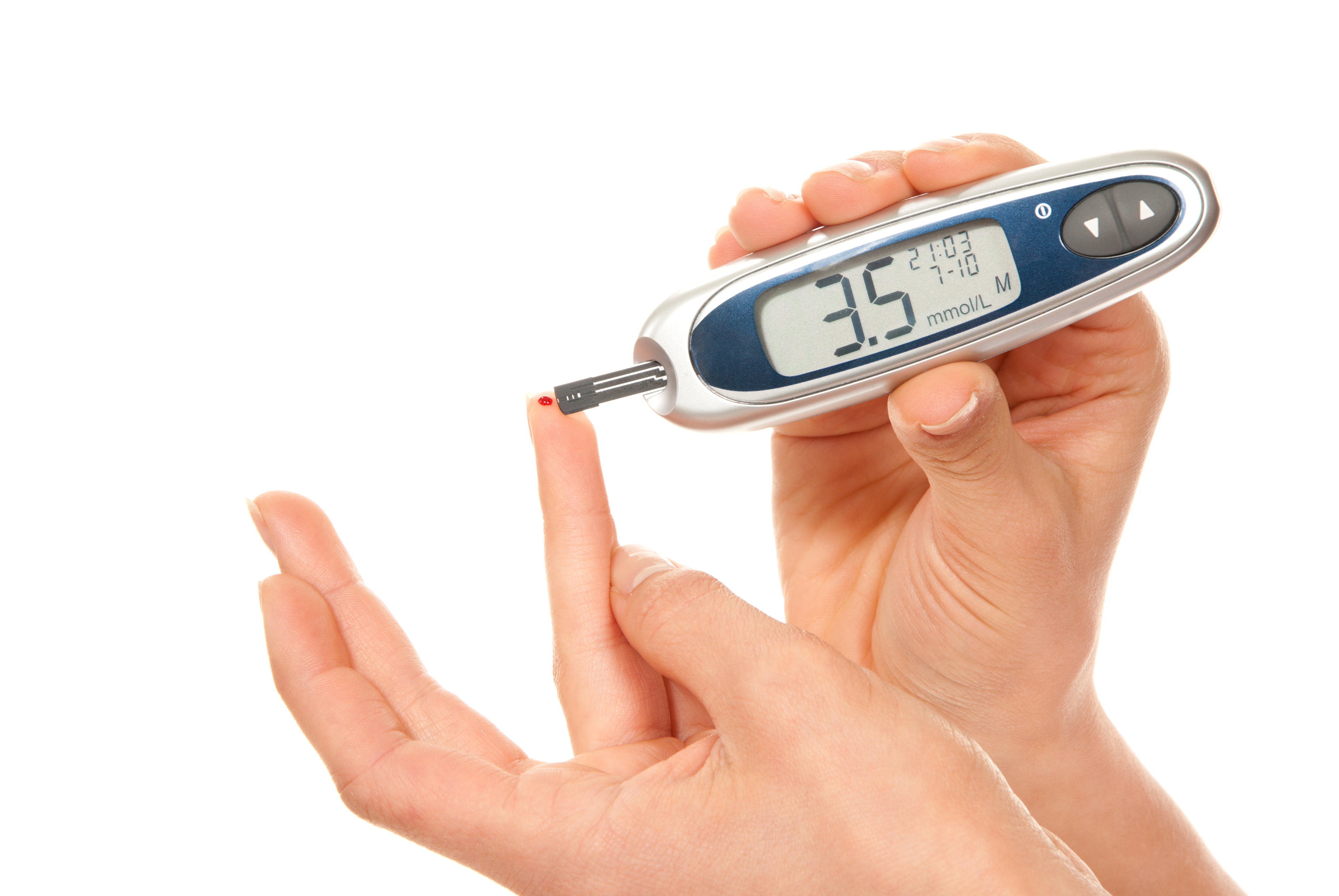 Diabetes patient measure glucose level blood test using ultra mini glucometer and small drop of blood from finger and test strips isolated on a white background. Low blood sugar