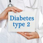 Diabetes Type 2 card in hands of Medical Doctor