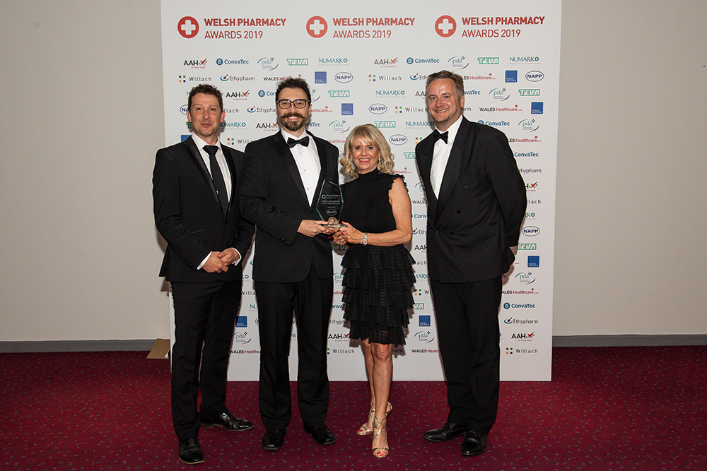 Management of Diabetes in Community Pharmacy Award winner, Nathan Wood and Team, Queens Road Pharmacy, Skewen, with Tim Railton, Napp Pharmaceuticals Limited, and Paul Gimson, National Primary Care Manager and Medicines Safety Programme Lead at 1,000 Lives Improvement