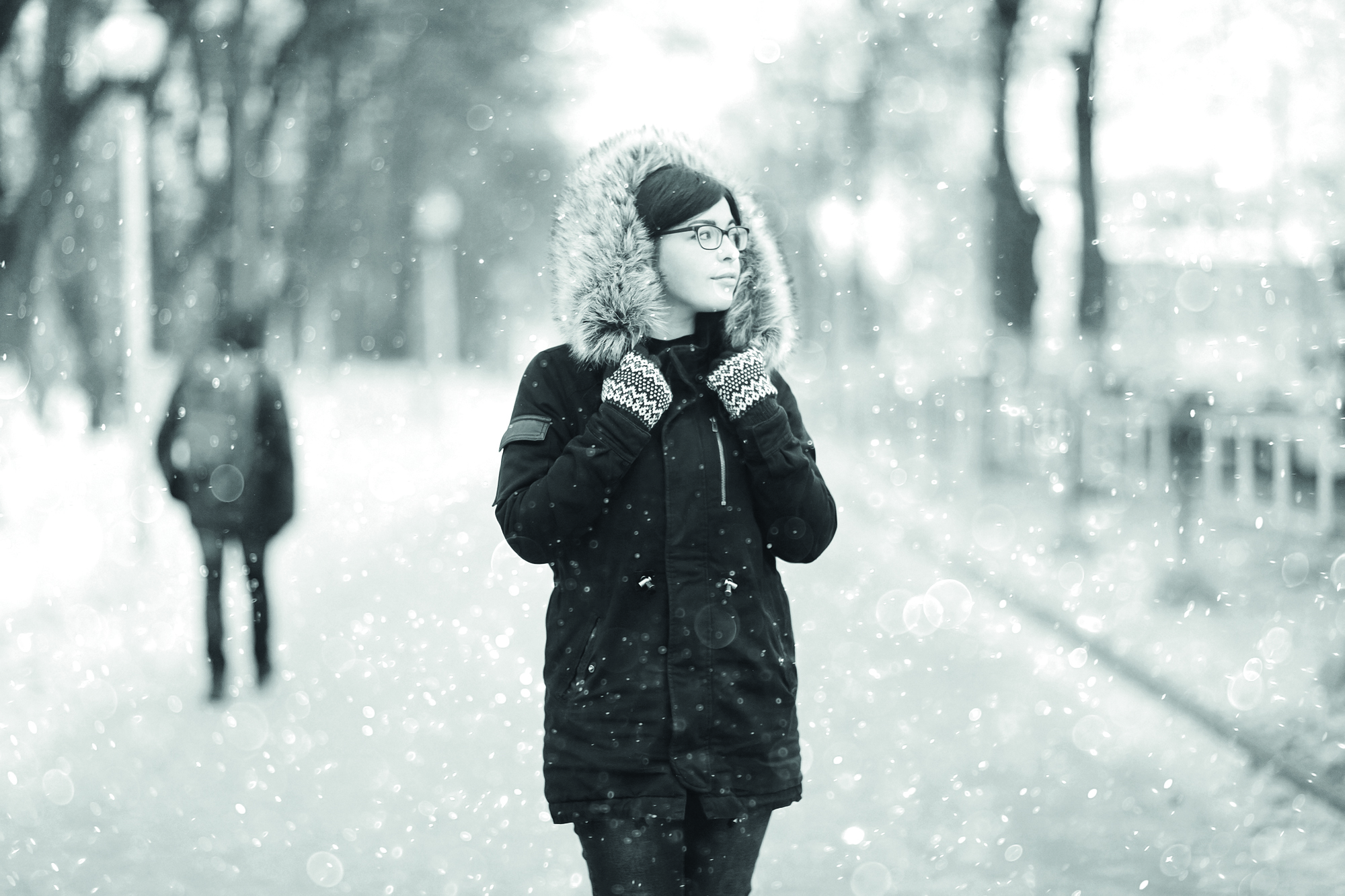 portrait of a girl in a snowy winter park Christmas Walk