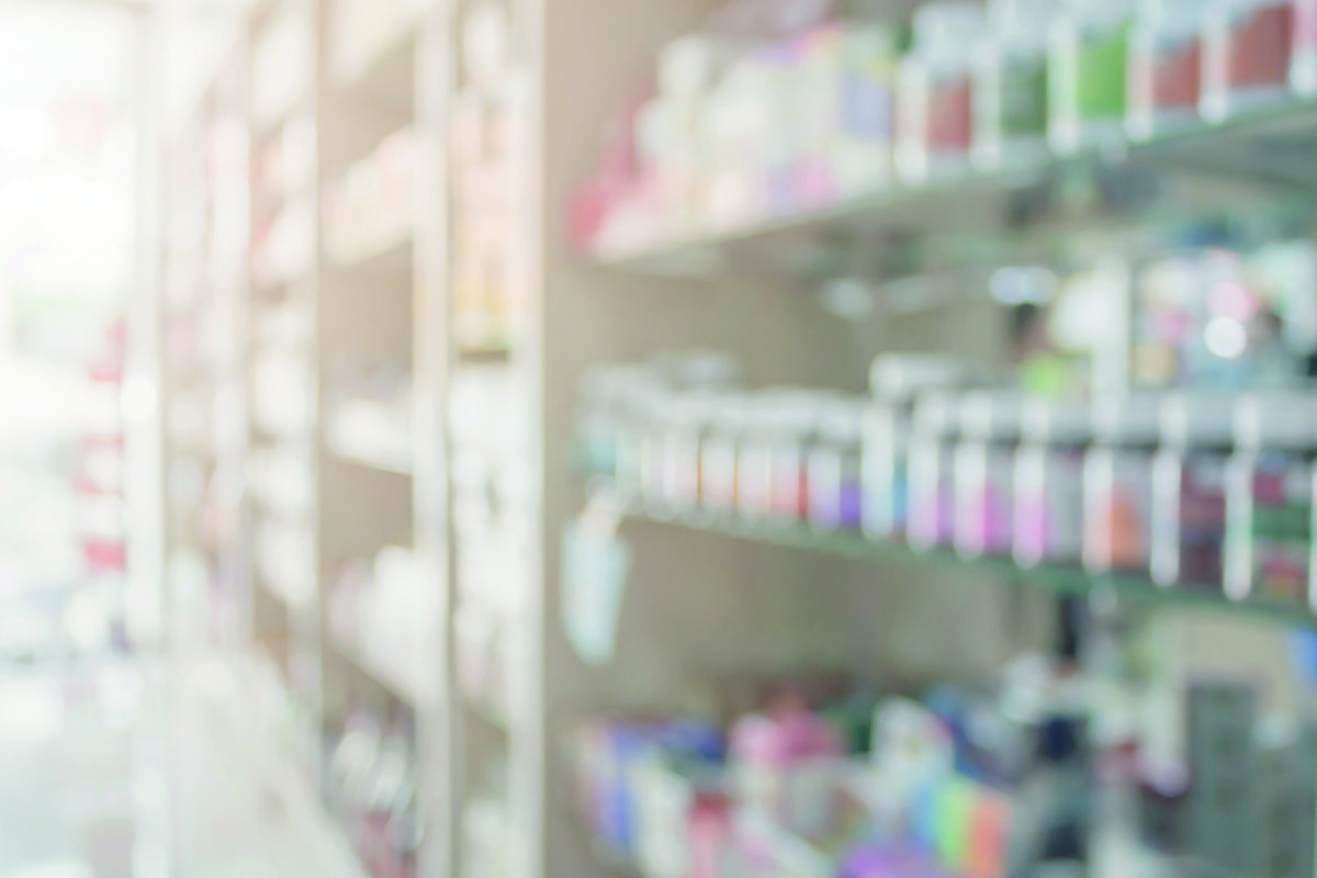 Pharmacy blur background with medicine on shelves