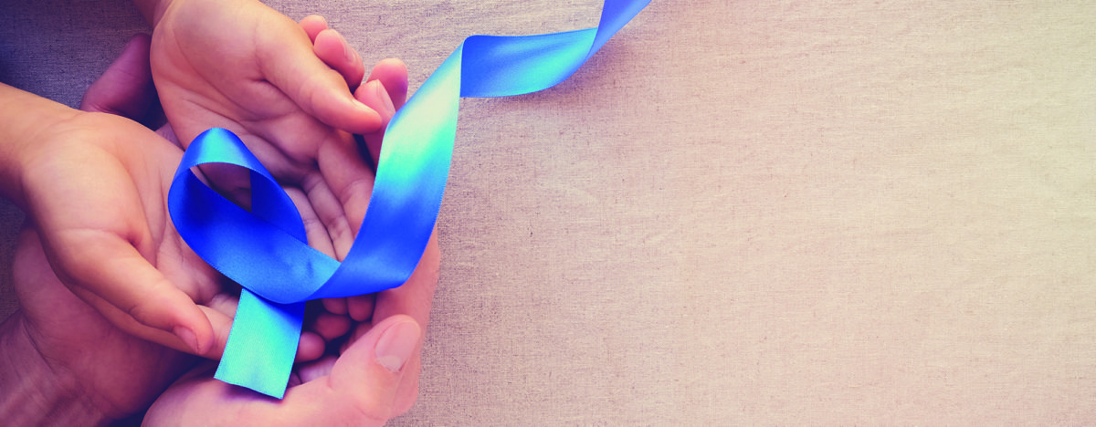adult and child hands holding Blue ribbon, Colon Cancer, Colorectal Cancer, Child Abuse awareness, world diabetes day
