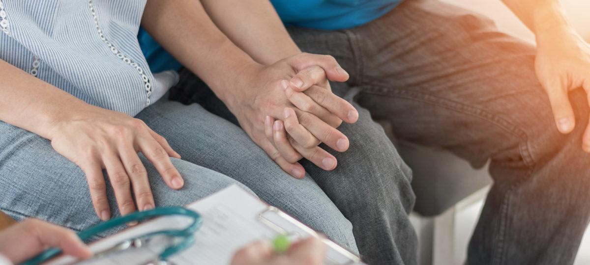 Patient couple consulting with doctor or psychologist on family men and women's medical healthcare therapy, In vitro fertility IVF treatment for infertility, or sexual health concept