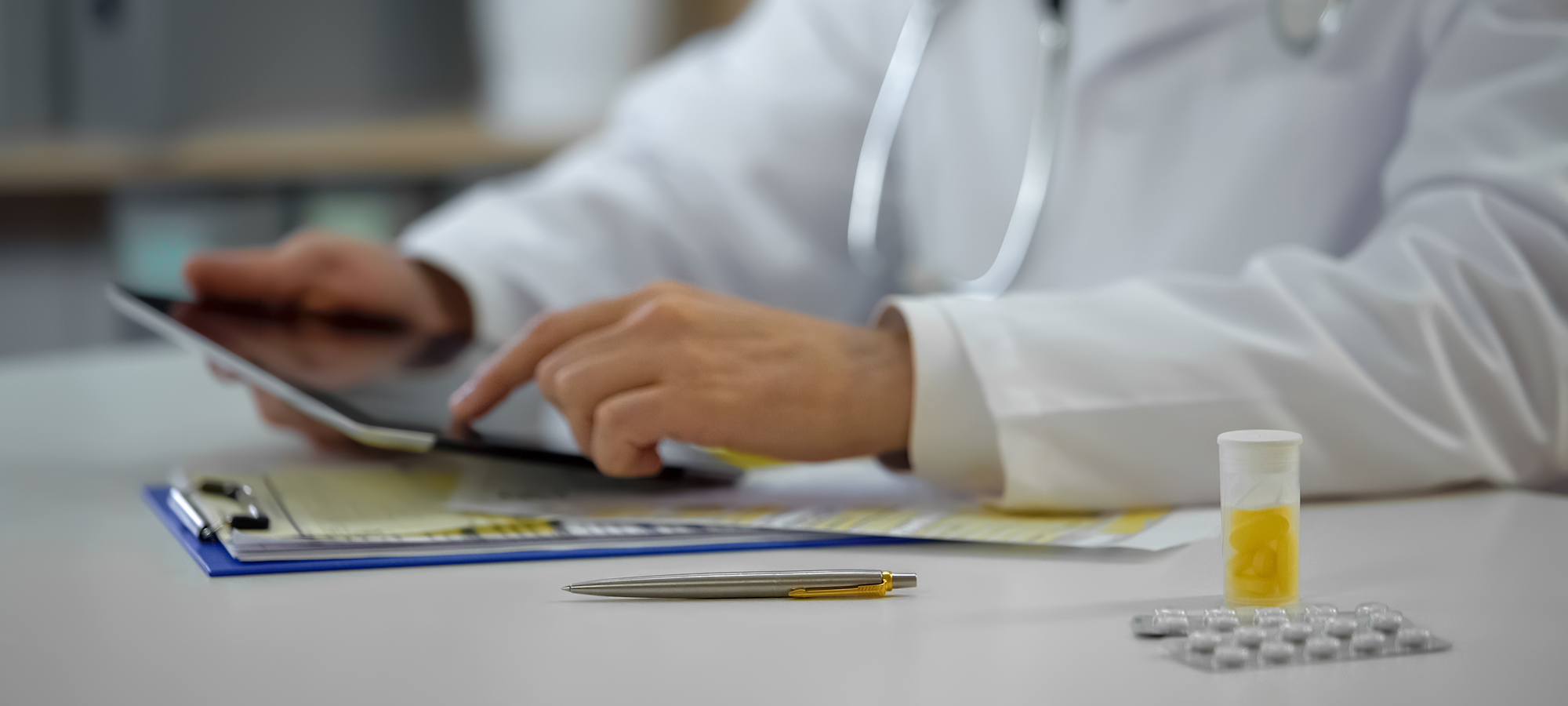 Head physician consulting patient online using tablet, modern te